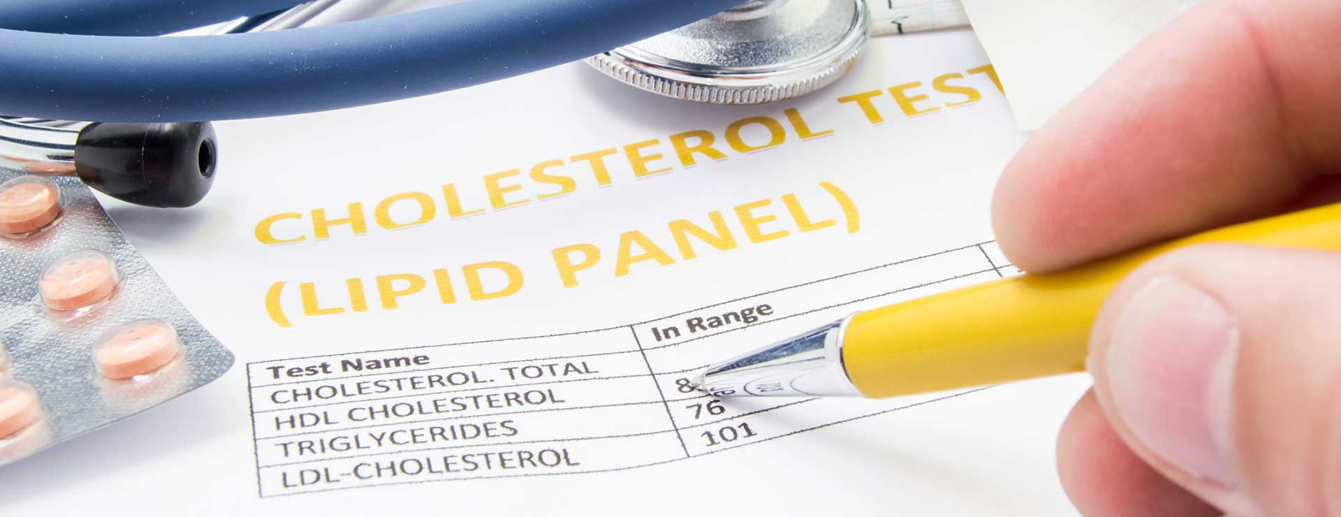 Doctor reviewing a lipid panel test for cholesterol