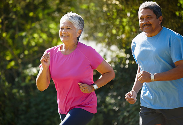 Elderly couple together running outdoors