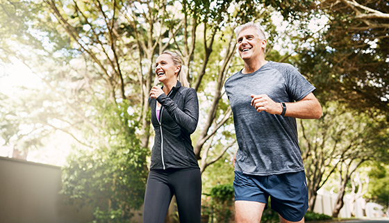 exercise and heart health - mature couple jogging
