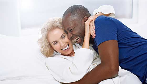 senior couple embracing in bed