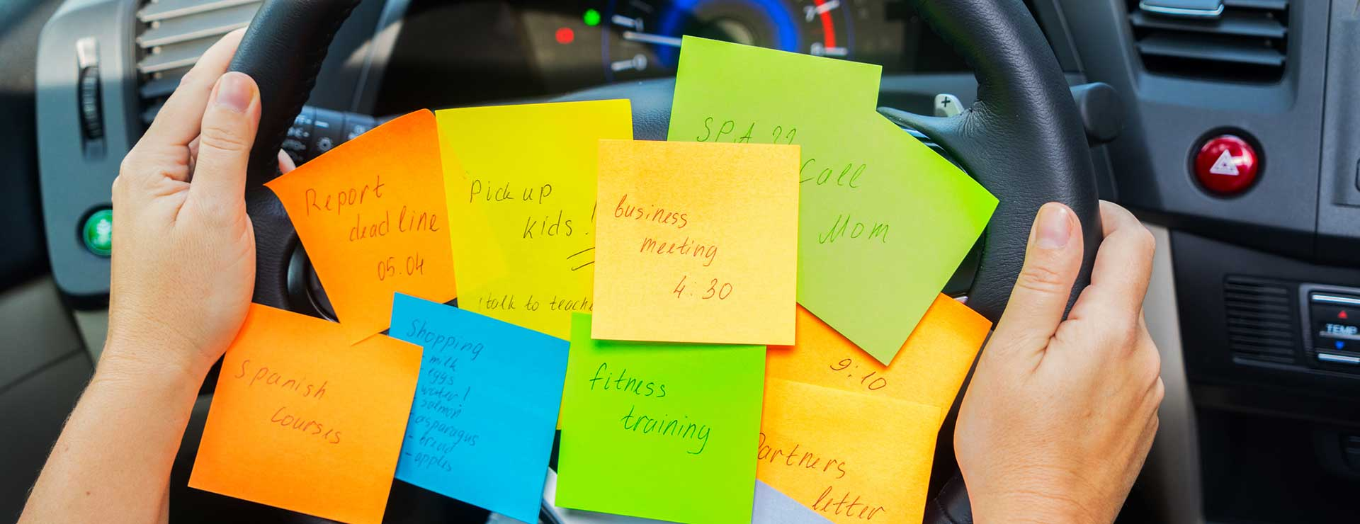 to-do list sticky notes attached to the steering wheel