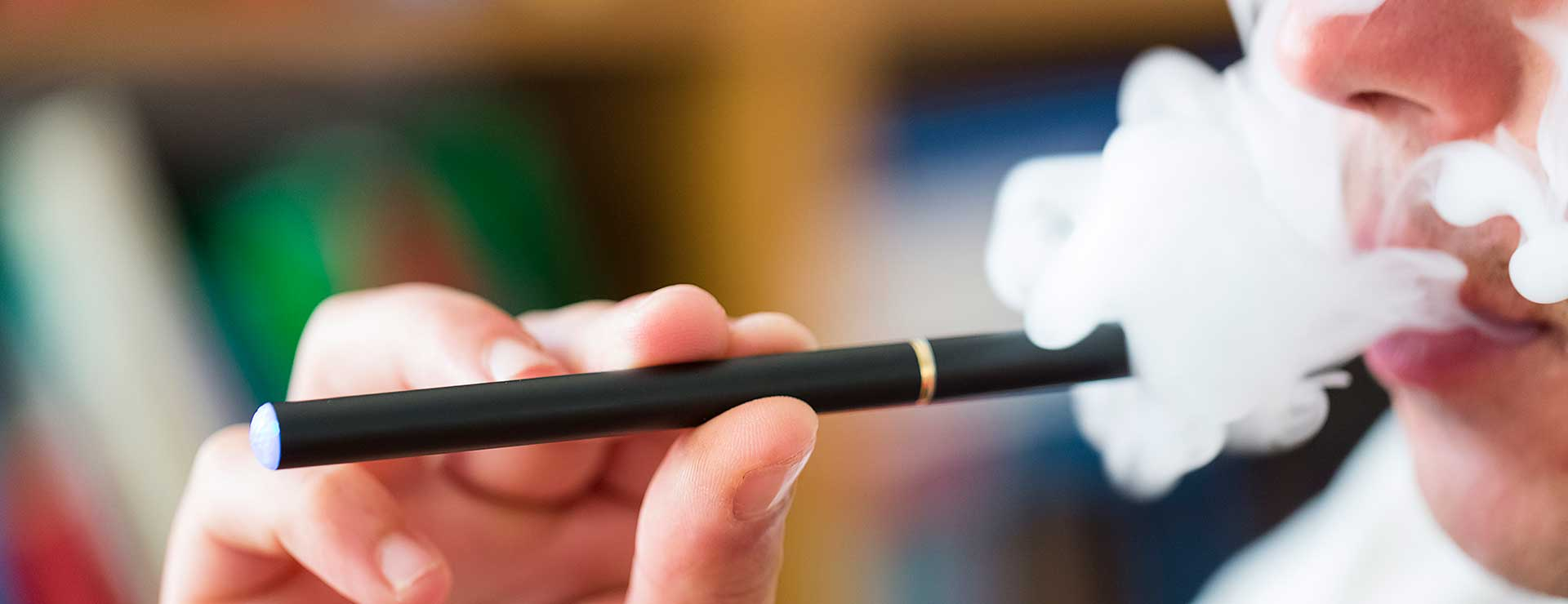 a man using a vaping e-cigarette