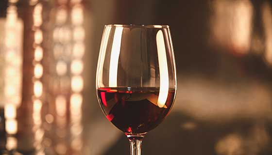 wine glass filled with red wine