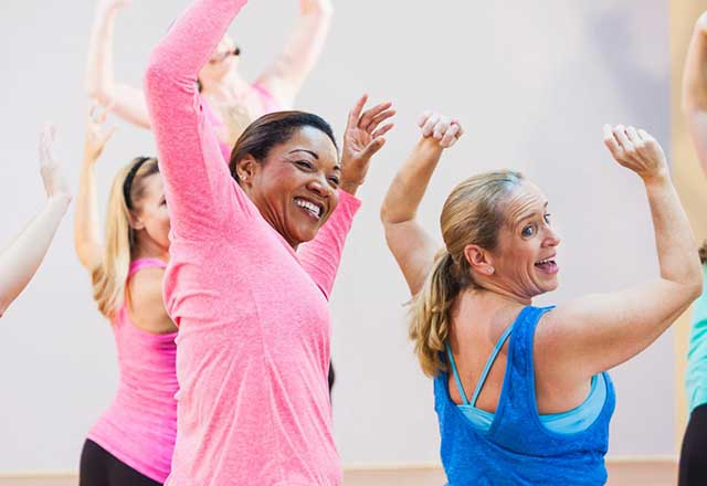 A group of women having fun in an exercise class.
