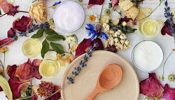 An assortment of flowers and salves.
