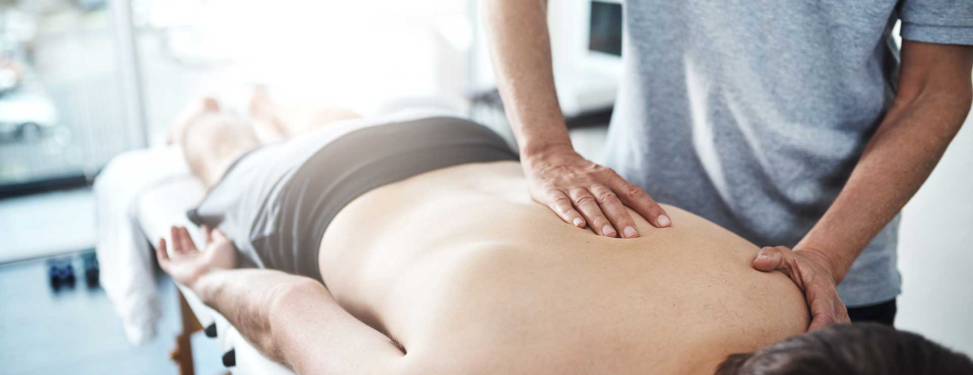 A person receives chiropractic care.