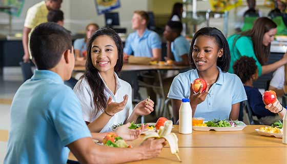 teens eating during school lunch