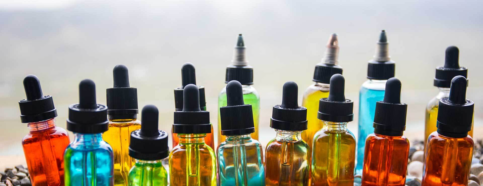 an assortment of vape juice flavor bottles
