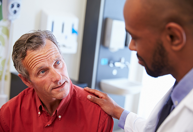 older gentleman having consultation with doctor