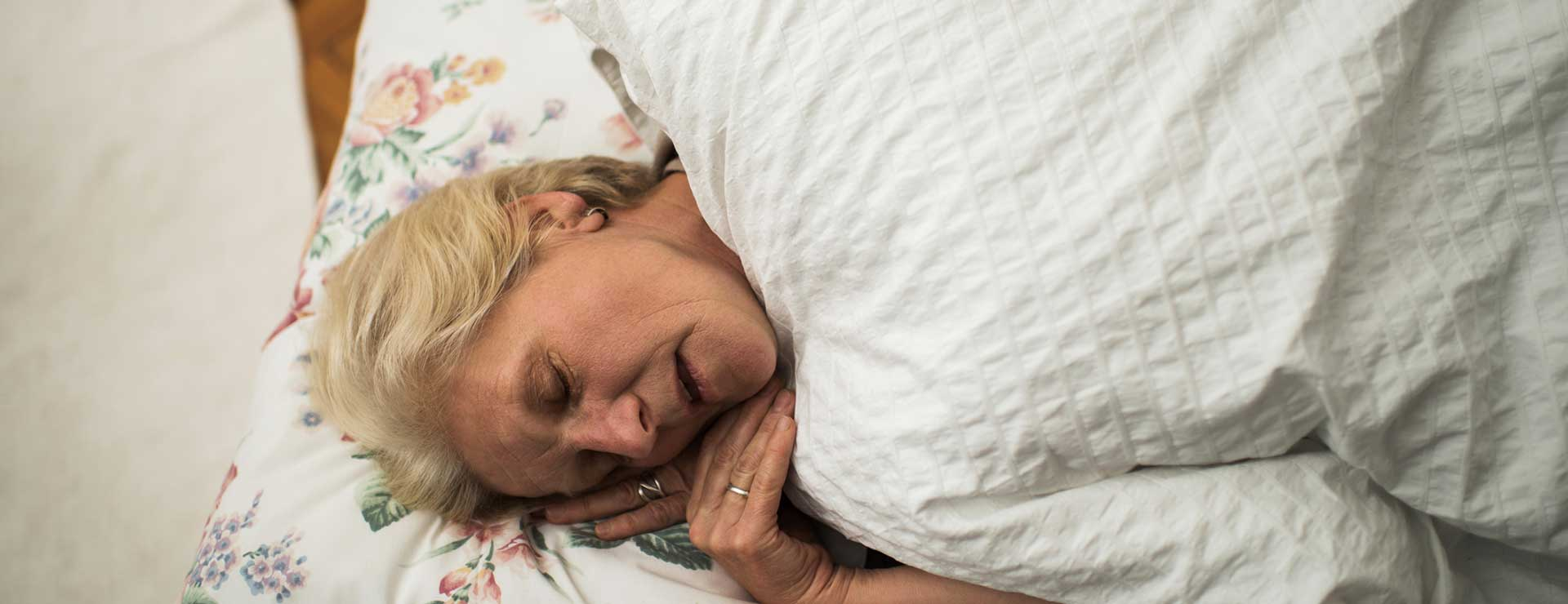 A senior woman sleeping with mouth open