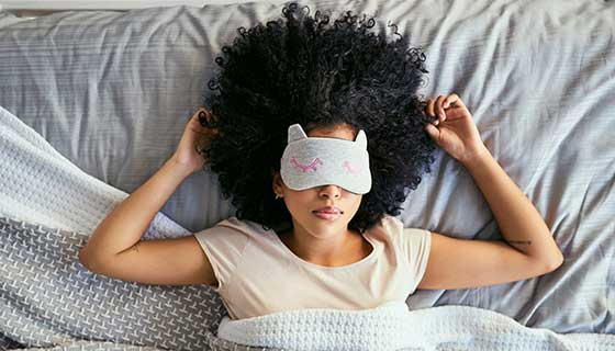 Woman sleeping with a sleep mask on