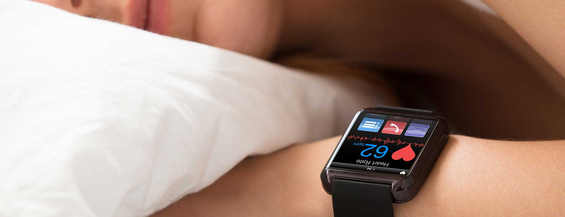 A person sleeping with a smart watch