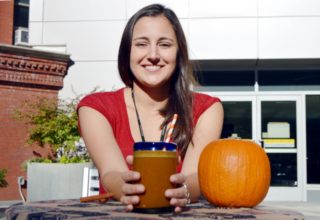 Johns Hopkins research nutritionist Diane Vizthum holding a cup of the healthy pumpkin coffee smoothie.