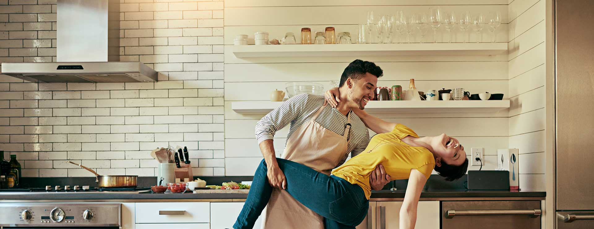A couple dancing in the kitchen