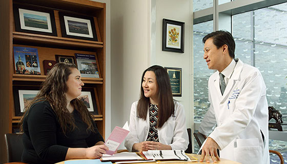 two doctors consulting with a woman