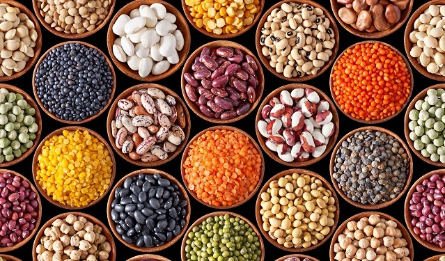 Many varieties of dried legumes in tiled pattern