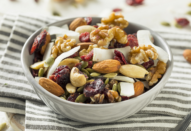 snack mix of nuts and dried fruit in bowl