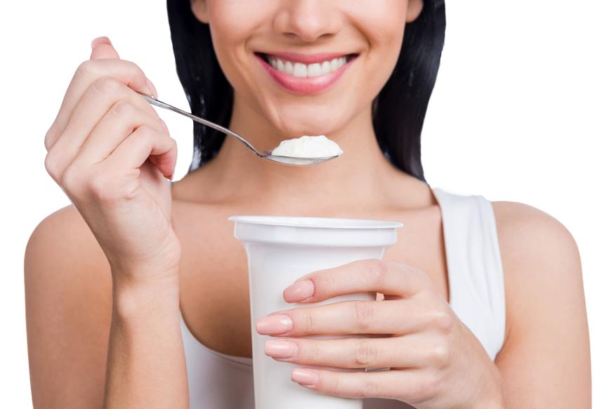 woman holding yogurt