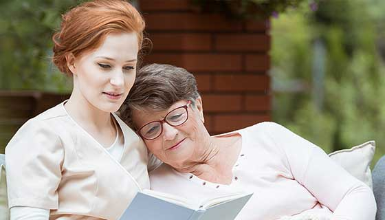 woman reading with caregiver