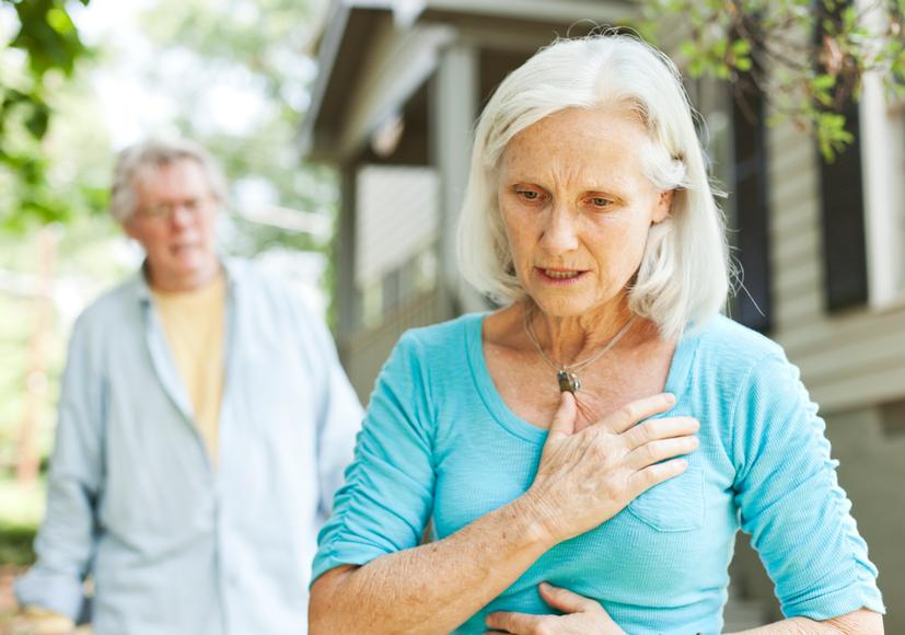 Older woman with heartburn
