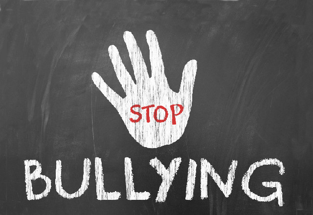 """Stop bullying"" drawing on chalk board"