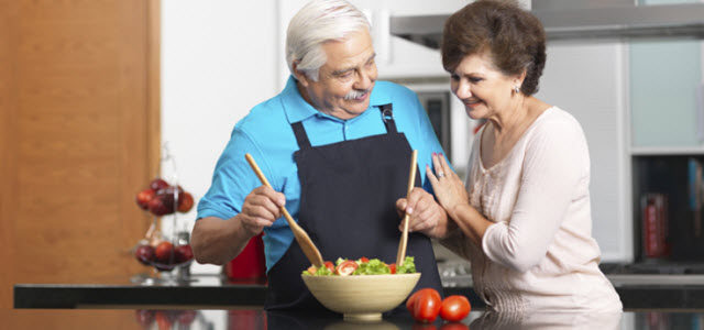 older couple cooking