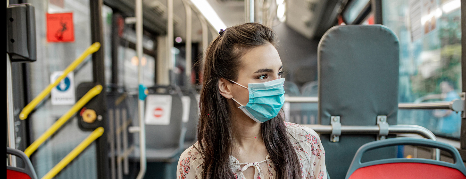Woman in a mask on the bus