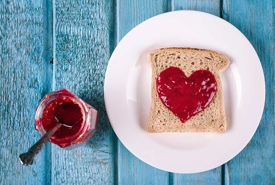 Jam spread on toast in the shape of a heart