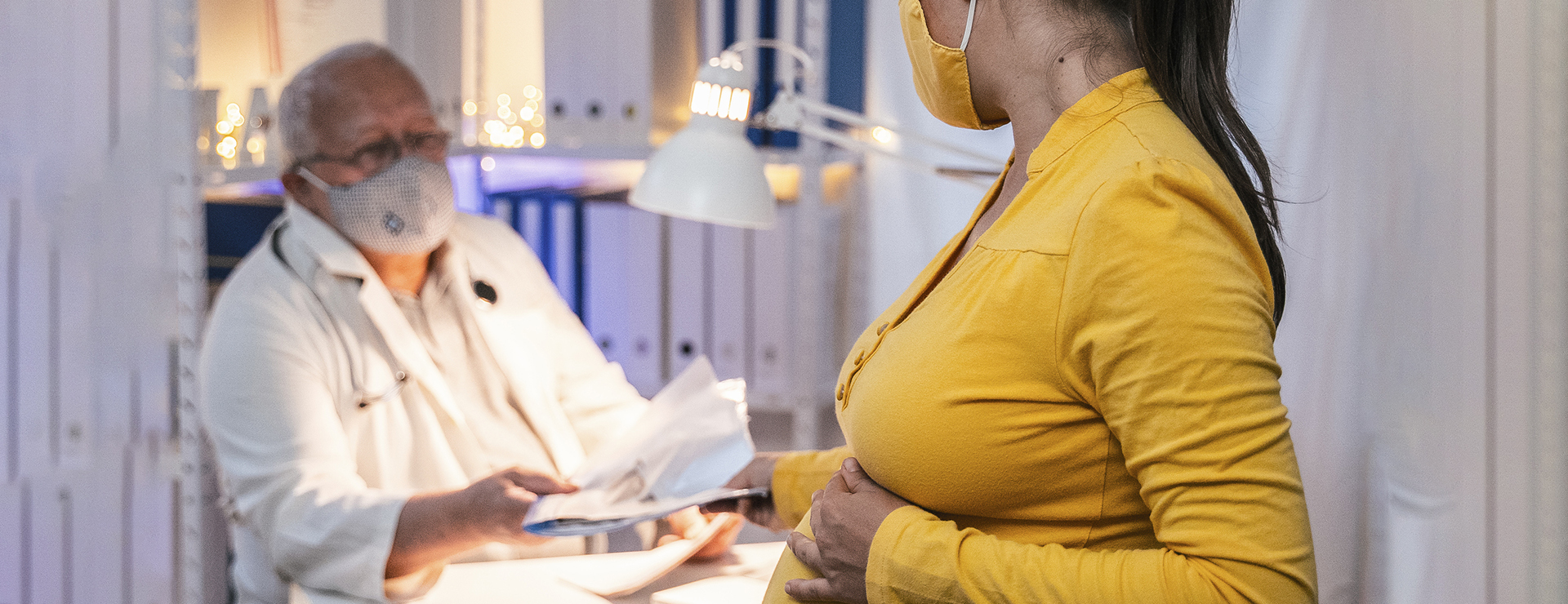 a pregnant woman and a doctor
