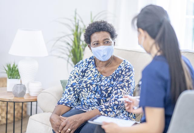 Physician with patient in home