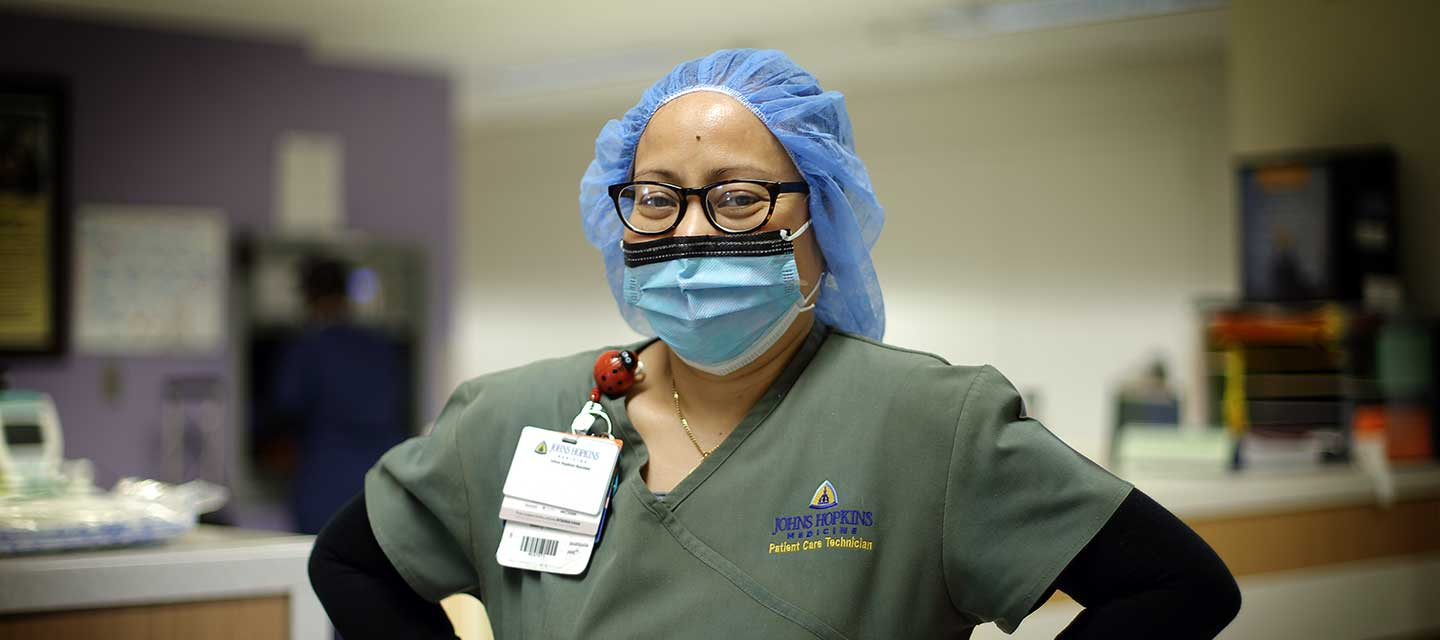 Employee smiling behind her mask