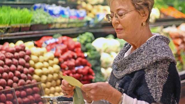 Woman reading her list in the produce aisle