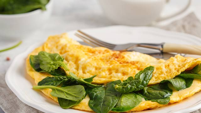 Spinach omelette on a white plate