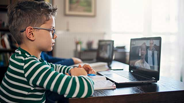 Young boy participating in an online class