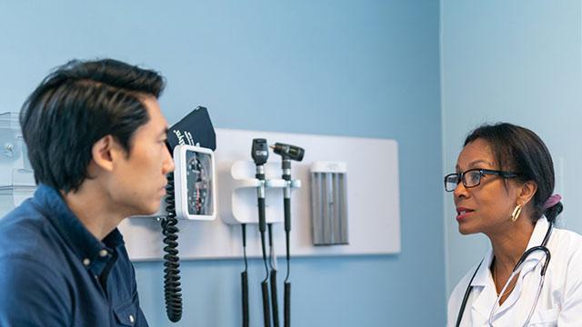 Patient speaks with doctor