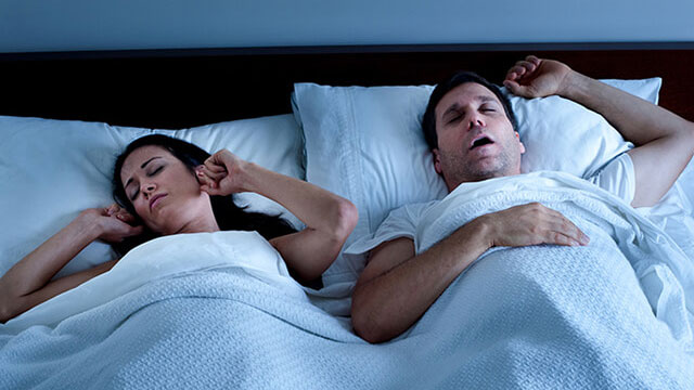 Woman kept awake by husband's snoring.
