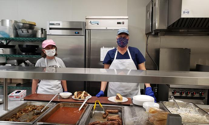 behind the line at a food kitchen
