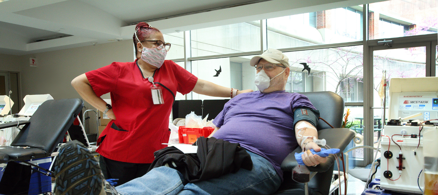 Man giving blood at a blood drive