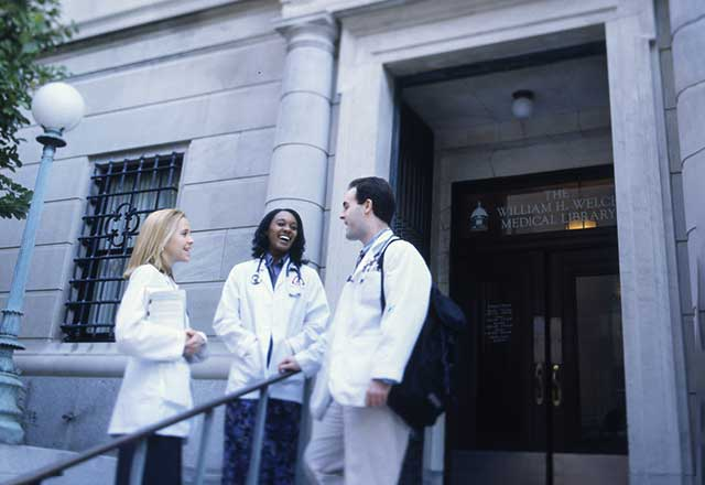 Medical students standing outside the Welch Medical Library