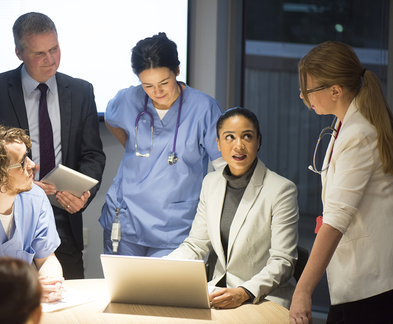 A group of medical professionals discussing business.