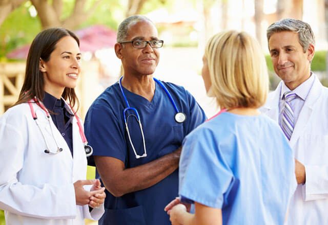 doctors talking in a circle