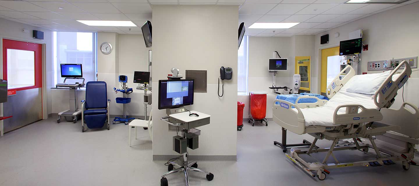 Wide shot of the bioncontainment unit room with monitors.
