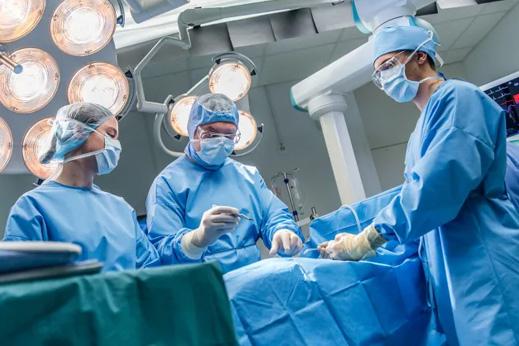 Surgeons performing surgery.