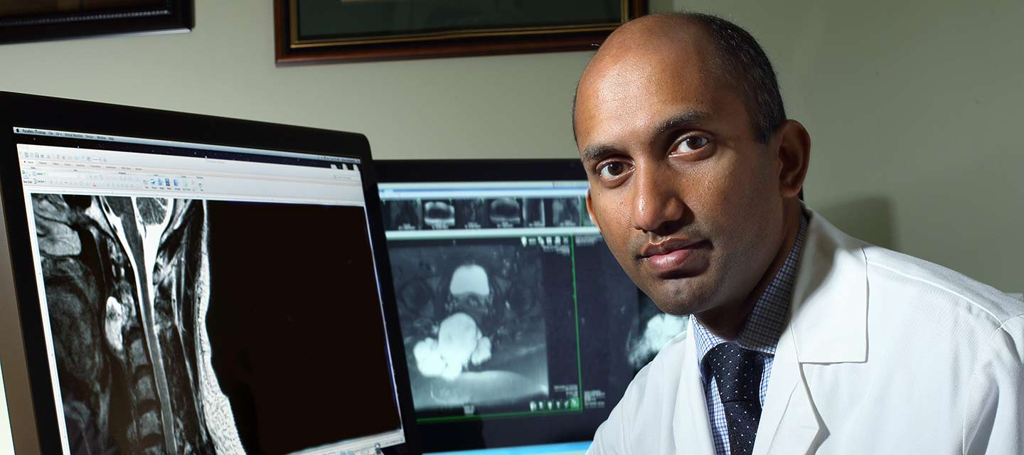 Dr. Bettegowda examining a scan on his computer