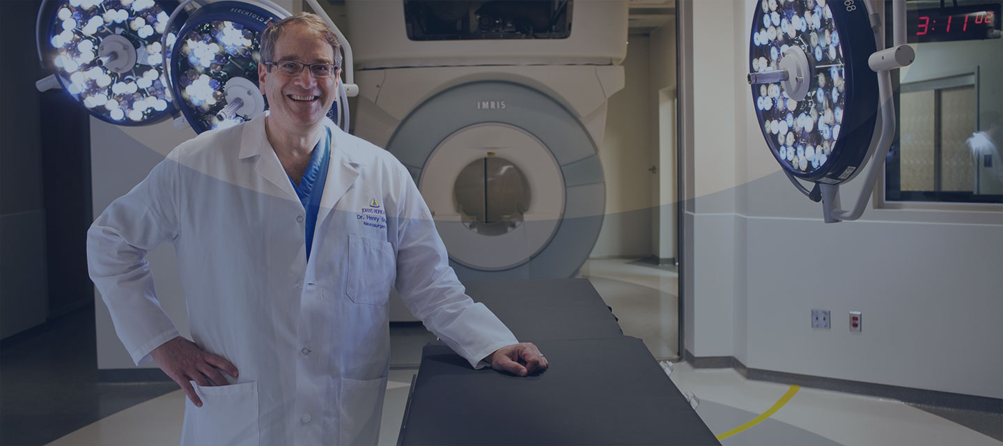 Dr. Brem standing in front of an mri machine