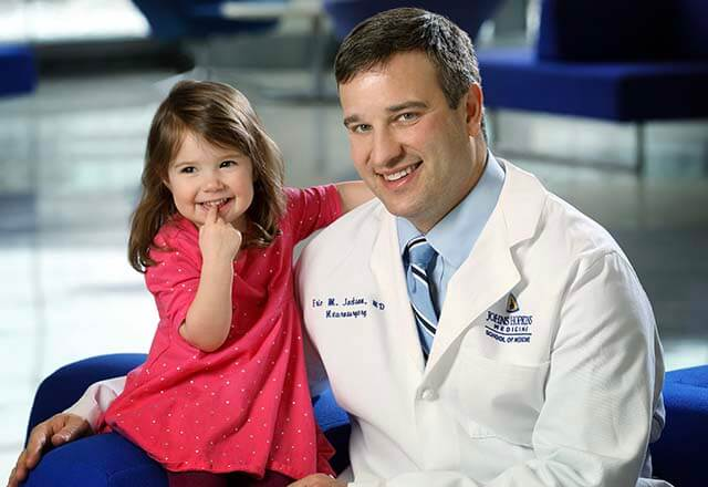 Dr. Eric Jackson with a patient