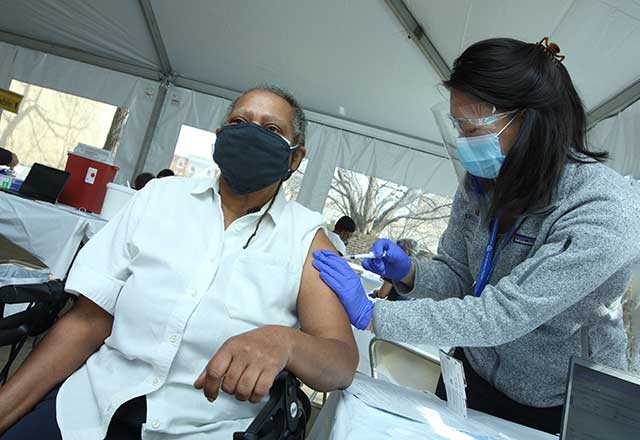 Community member being vaccinated by a healthcare worker.