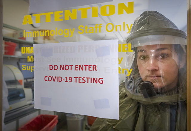 Bethany Peters wears hazmat suit in COVID19 clinic
