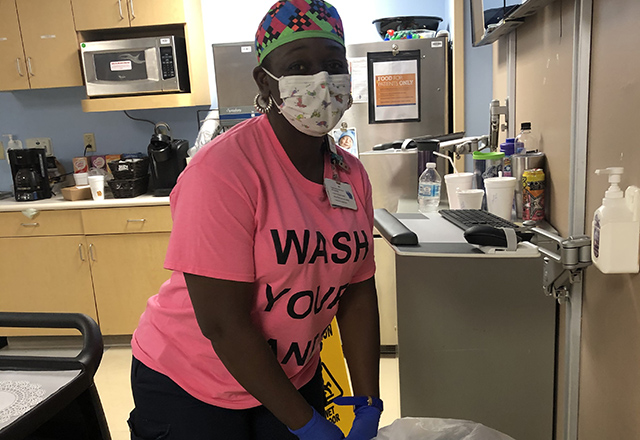 Health care worker wearing PPE while working
