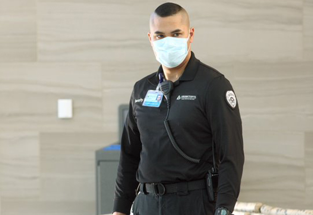 Dominick Metzger stands, wearing a mask.